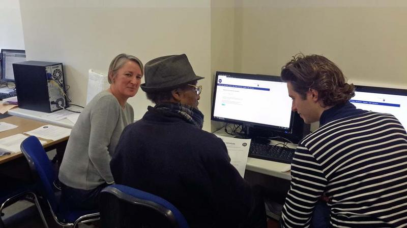 Citizens Advice researchers discussing web form usability with a dropin user (centre)