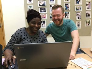 Christina and FCA volunteer Nick looking at a laptop