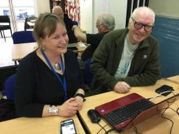 FCA volunteer Petra helping Hugh understand his laptop