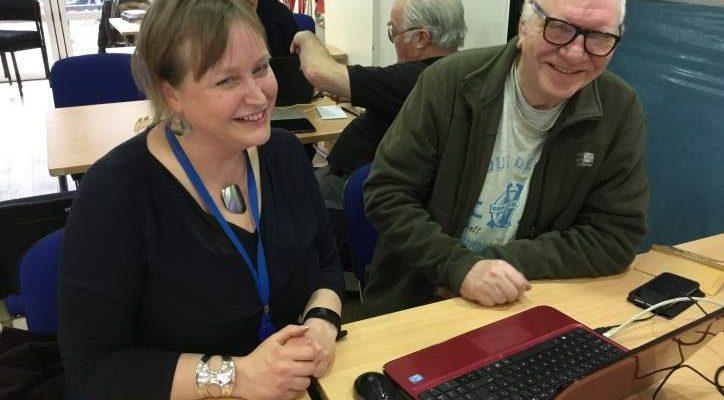 FCA volunteer Petra is helping Hugh with his laptop
