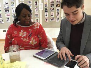 Volunteer Oliver is fixing Anne-Marie's iPad
